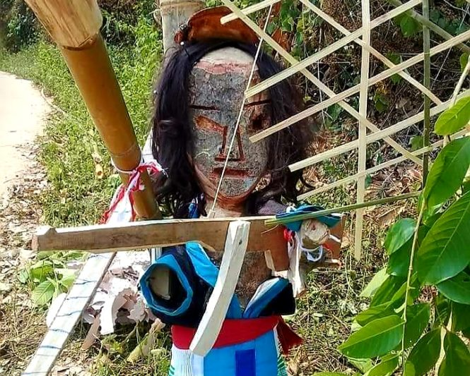 scarecrow in a Lao village